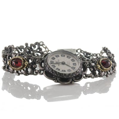 Mechanische Handaufzug Trachten Uhr von Anker aus Silber 835 und Granat