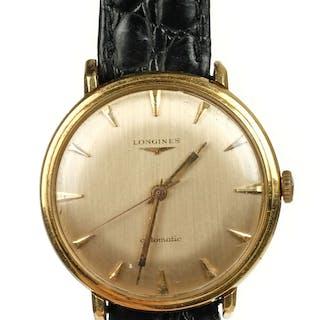 * Longines. A gentleman's Longines Automatic 18K gold wristw