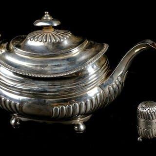 * Teapot. A George III silver teapot, London 1817