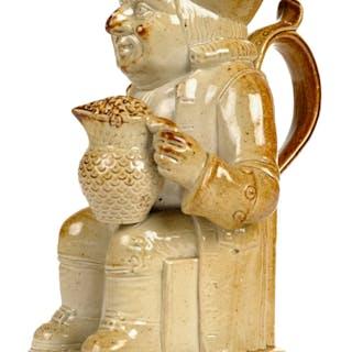 * Toby Jug. A 19th Century salt glaze stoneware Toby jug