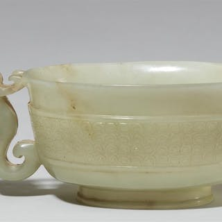 A finely carved celadon jade handle cup. 17th century