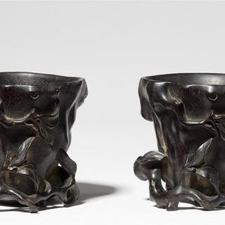 Two almost identical black wood libation cups, probably zitan wood