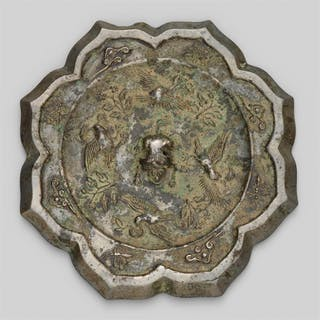 A silvery bronze mirror. Tang dynasty