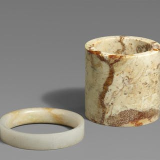 A jade ring and a stone cylinder