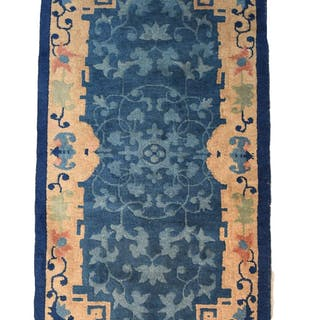 A Chinese 19th century woven blue ground prayer rug with cre