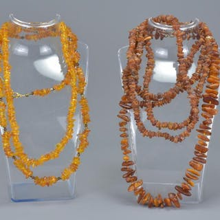 A group of four strung amber chip bead necklaces. (4)