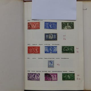 A QEII stamp album (460) together with a dark green 16 page stock