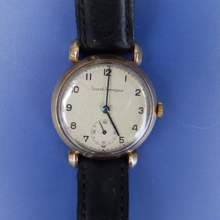 A gent's Giraud Perregaux 9ct gold wrist watch with subsidiary seconds