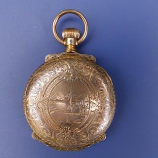 An Elgin 14K hunter cased pocket watch with white enamel dial having