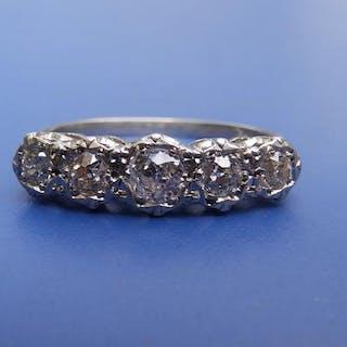 A gradutaed five stone diamond ring, the illusion set stones in 'PLAT'.