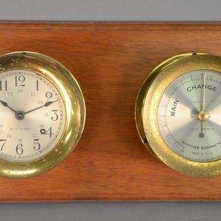 Seth Thomas brass clock and barometer, mounted on board. 8 1