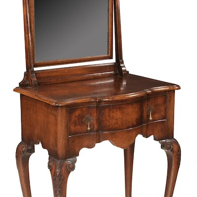 Queen Anne style walnut shaped front dressing table with dom