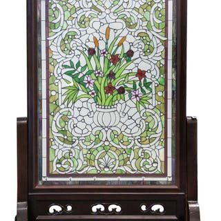 A CONTEMPORARY STAINED GLASS FIRE SCREEN WITH WOODEN FRAME