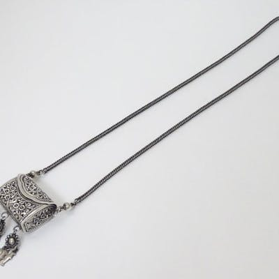 A white metal pendant pomander of purse form with …