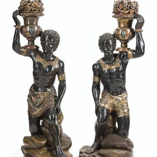 A pair Venetian polychrome seated Blackamoors