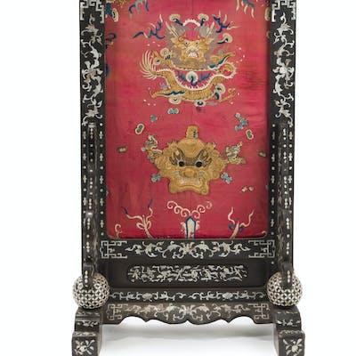 A Chinese silk and ebonized wood screen