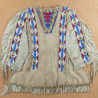 A framed Plains beaded war shirt