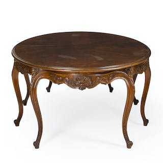 A French Louis XV-style oak dining table