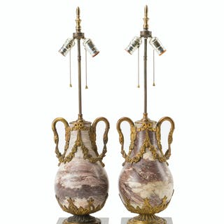 A pair of gilt bronze-mounted marble lamps