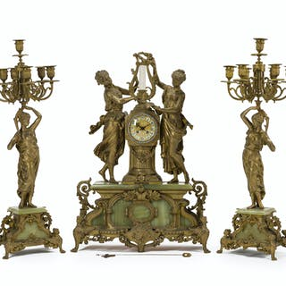 A gilt metal figural clock and garniture set