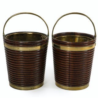 A pair of Irish Regency mahogany and brass peat buckets