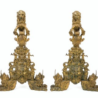 A pair of gilt bronze and cast iron andirons