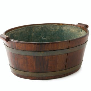 An English Georgian mahogany cistern