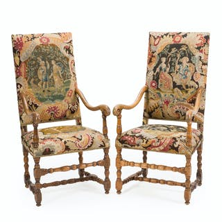 A pair of carved walnut armchairs
