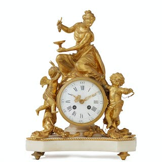 A French figural gilt-bronze table clock