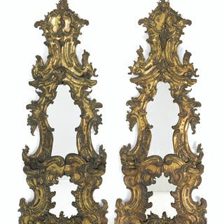 A pair of Flemish embossed brass pier glass mirrors