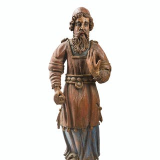 A carved wood biblical figure