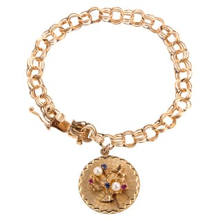 A Ladies Vintage Charm Bracelet in 14K Gold