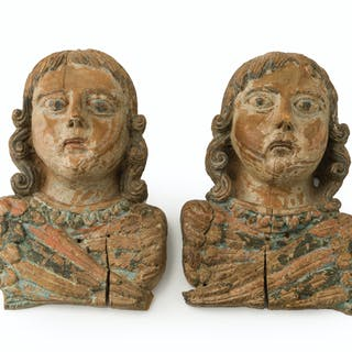 A pair carved wood angel busts