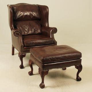 CHIPPENDALE STYLE LEATHER WING CHAIR AND OTTOMAN