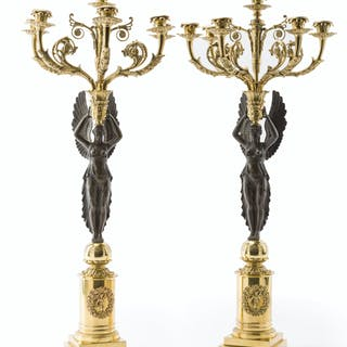 A pair of Empire-style candelabra
