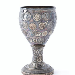 A silver coin-set chalice