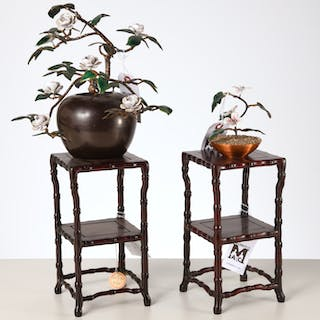 Enameled floral arrangements on Chinese stands