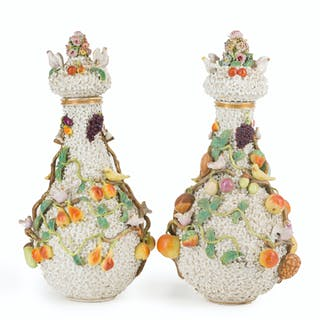 A pair of Meissen lidded urns