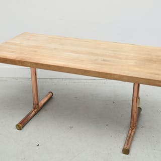 Modern butcher block and copper trestle table