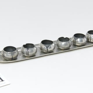 A.E. Chanal French Art Deco pewter salt set