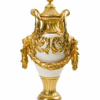 A gilt bronze-mounted white marble urn