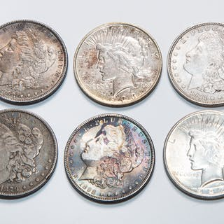 A half dozen US silver dollars