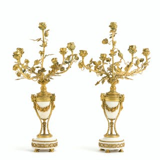 A pair of Louis XVI-style candelabra