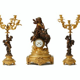 A French gilt and patinated bronze clock and garniture set
