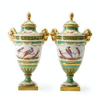 A pair of Vincent Dubois porcelain lidded urns