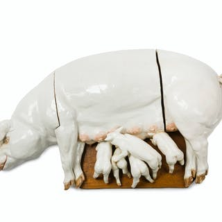 A Continental glazed ceramic sow and five piglets