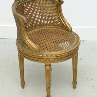 Old Louis XVI style giltwood swivel bergere