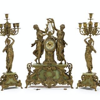 A gilt metal figural clock and garniture set