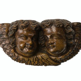 A carved wood cupid corbel