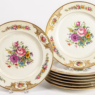 Eight Limoges painted porcelain plates